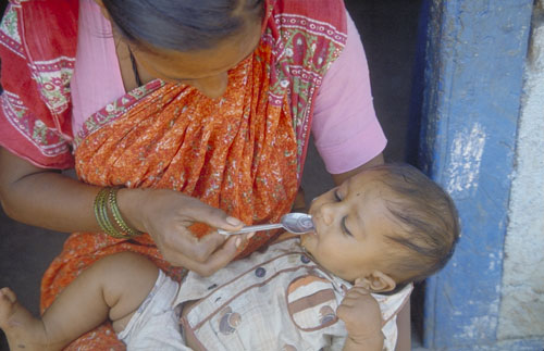 Mother feeding child oral rehydration solution